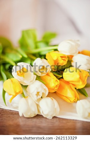 bouquet of fresh yellow and white tulips - stock photo