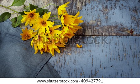 bouquet of fresh yellow flowers on wooden background - stock photo