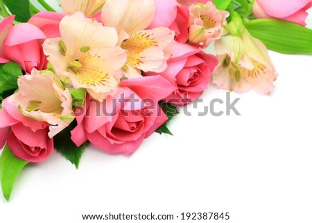 Bouquet of hot pink roses, pale pink flowers, and green leaves. - stock photo