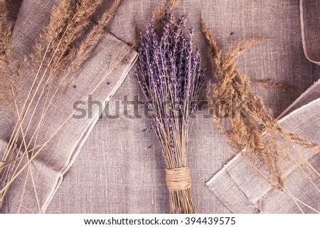 bouquet of lavender on sacking - stock photo