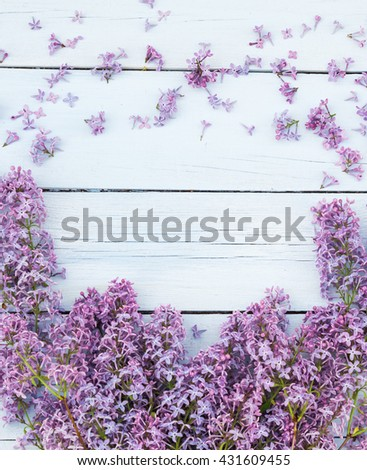Bouquet of lilacs flowers on a light blue shabby wooden background. Vintage floral background with purple flowers. Copy space - stock photo