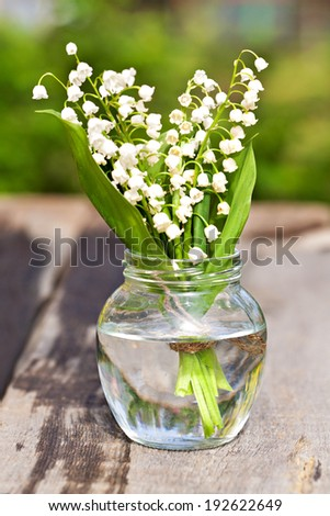 Bouquet of lily of the valley outdoor - stock photo