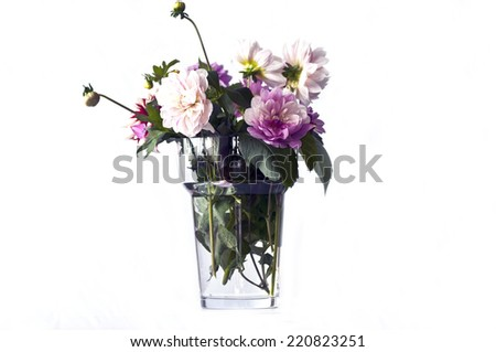 Bouquet of many beautiful  flowers in glass vase isolated on white background  - stock photo