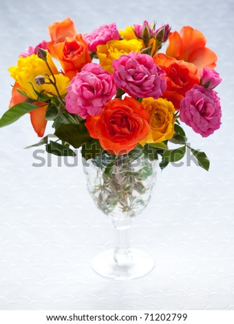 bouquet  of multi-colored roses in vase - stock photo