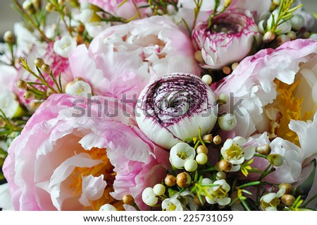 Bouquet of peonies and buttercup - stock photo