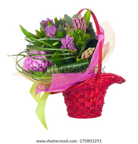 Bouquet of peonies, hyacinths and other flowers in red wicker basket isolated on white background. Closeup. - stock photo