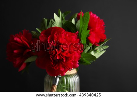 Bouquet of peony flowers on black background