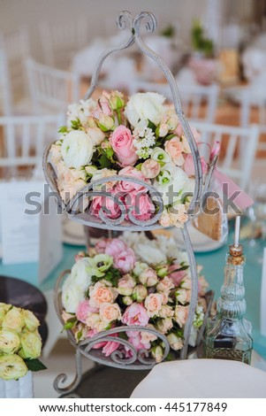 Bouquet of pink and white roses lies on a steel stand