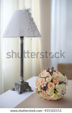 bouquet of  pink and white roses on the table near the lamp with the lamp shade - stock photo