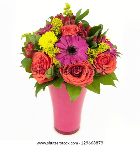 bouquet of pink and yellow flowers in vase isolated on white - stock photo