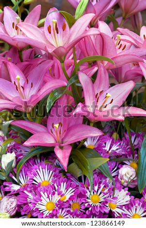Bouquet of pink lilies and gerberas. Abstract background. - stock photo