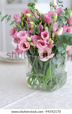 Bouquet of pink lisianthus in  glass vase - stock photo