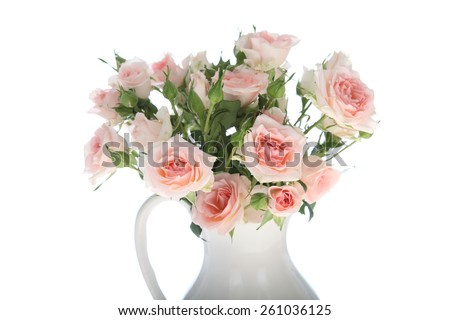 Bouquet of pink roses  in a vase isolated on a white background - stock photo