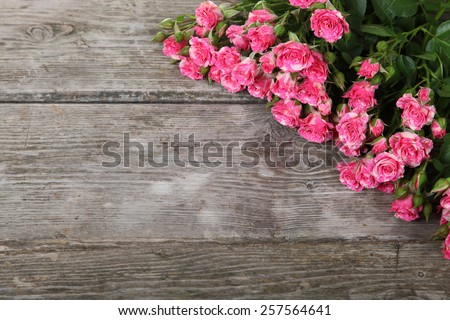 Bouquet of pink roses on a wooden background - stock photo