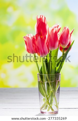 Bouquet of pink tulips in vase, copy space