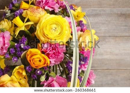 Bouquet of ranunculus, daffodil and carnation flowers, copy space - stock photo