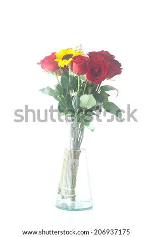 bouquet of red roses and sunflower in a vase  - stock photo