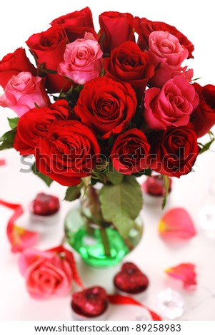 Bouquet of red roses in vase on white background.