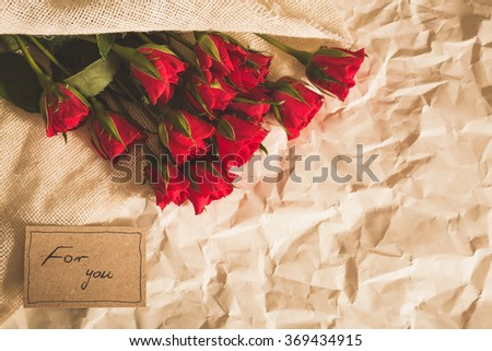 Bouquet of red roses is lovely and romantic surprise - stock photo