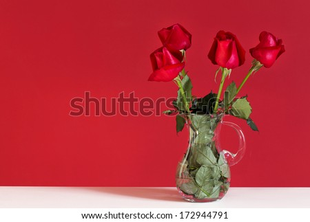 Bouquet of red roses isolated on red background