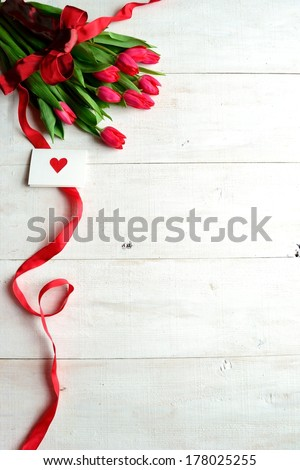Bouquet of red tulips with message card.Image of Valentine's day,Mother's day and gift. - stock photo