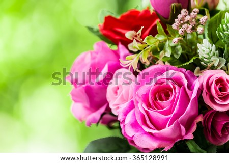 Bouquet of rose flower on blur green leaf background. - stock photo