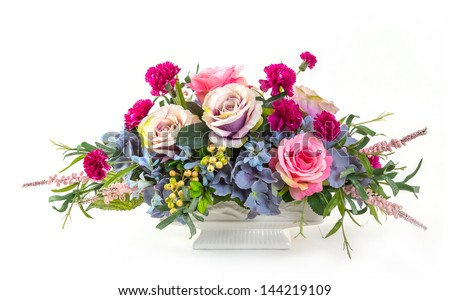 Bouquet of rose, hydrangea, berry and carnation flowers in ceramic pot - stock photo