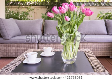 Bouquet of rose tulips on the table - stock photo
