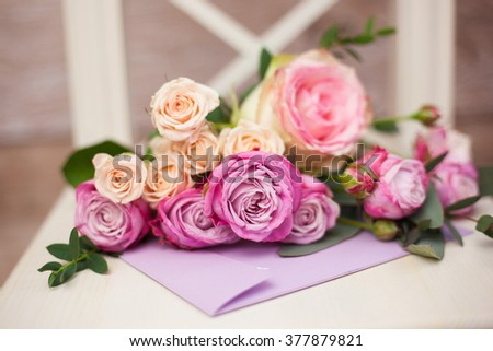 bouquet of roses and envelope with love letter