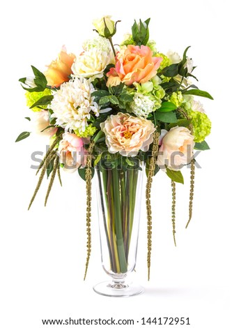 Bouquet of roses and hydrangea flowers in glass vase isolated on white