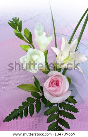 Bouquet of roses  and lily on pink background - stock photo
