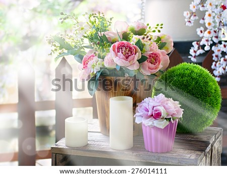 Bouquet of roses in a spring garden in the morning sunlight - stock photo