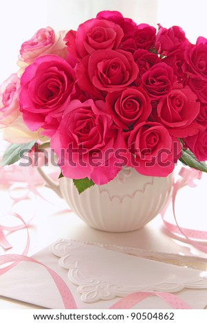 Bouquet of roses in vase for valentine's day - stock photo