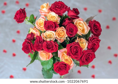 Bouquet of roses of two colors for beloved, many red hearts, top view, symbol of love,Valentine's feast and romantic celebrations