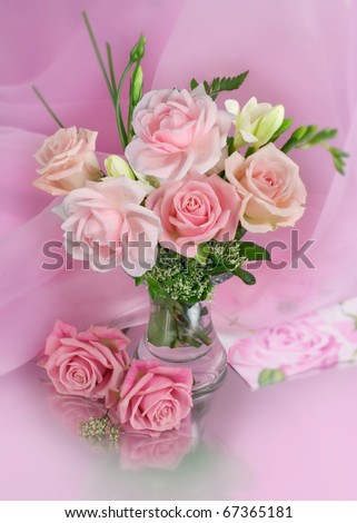 Bouquet of roses on pink background