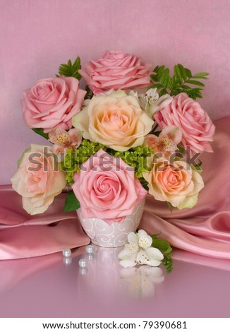 Bouquet of roses on pink background - stock photo
