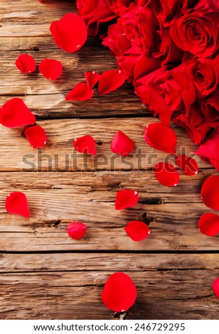 Bouquet of roses on wooden desk - stock photo
