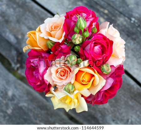 bouquet of roses on wooden table - stock photo