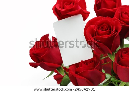 Bouquet of roses with blank gift card on white background - stock photo