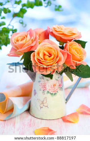 Bouquet of salmon-pink roses  in a jug - stock photo