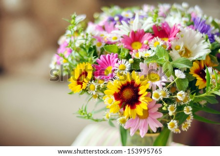 Bouquet of simple flowers on the table - stock photo
