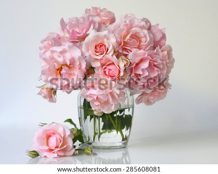 Bouquet of soft pink roses in a vase. Floral still life with roses. - stock photo