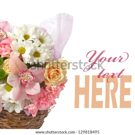 Bouquet of spring flowers in a wicker basket isolated on white background with place for text - stock photo