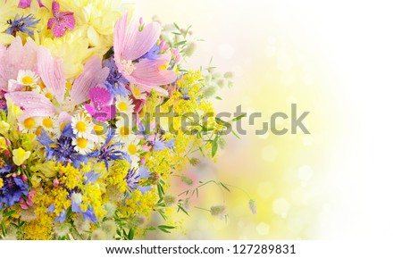 Bouquet of summer flowers with bokeh and copy space - stock photo