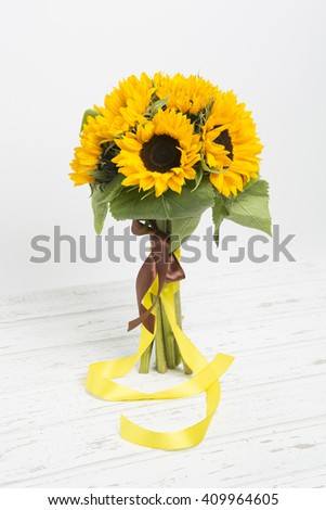 Bouquet of sunflowers on white wooden background - stock photo