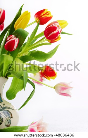 bouquet of the fresh tulips in vintage vase - stock photo