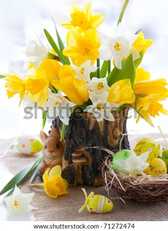 bouquet of the fresh tulips , narcissus and easter eggs  for Easter - stock photo