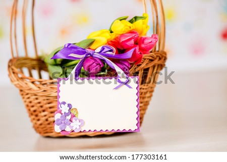 bouquet of tulips in a basket. card for congratulations. closeup. March 8, International Women's Day, Mother's Day - stock photo