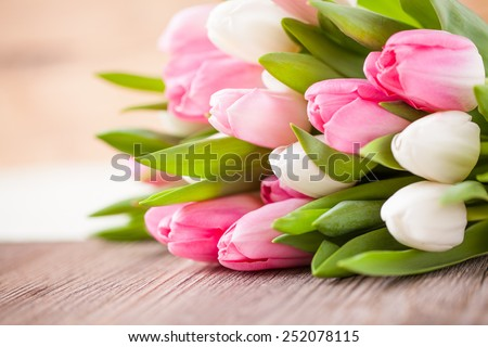 bouquet of tulips in front of spring scene - stock photo