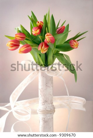 Bouquet of tulips in vase - stock photo